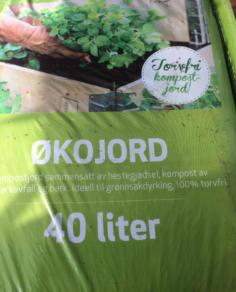 Jordsekk merket med torvfri kompostjord.